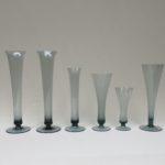 BV37 - 6 Stück Vasen, WMF, Entwurf Wilhelm Wagenfeld 1950 und 1951, turmalinfarbenes Glas
