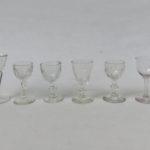 6 Schnapsgläser, ca. 1880, unterschiedliche Formen, Preßglas